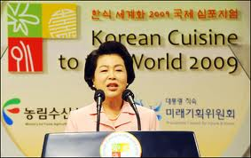 "According to KBS, ""First Lady Kim Yoon-ok says the government will actively support the globalization of Korean food. Speaking at the international symposium ""Korean Cuisine to the World 2009,"" Kim cited that Health Magazine out of the U.S. selected kimchi as one of the world's five healthiest foods and that the World Health Organization has labeled Korean dishes part of a nutritional and well-balanced meal."""